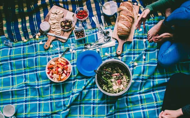 Picnic blanket with food banner image