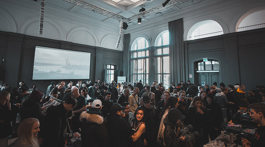 larger style event with plenty of people in the hall