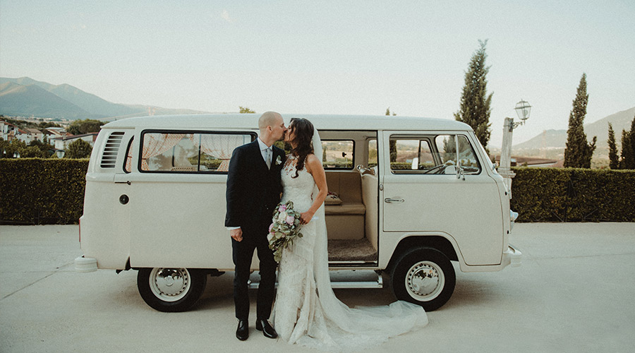 bride and groom enjoying a themed wedding with a travelling or rustic theme