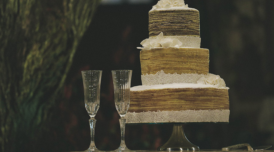 wedding cake and glasses on the table at a wedding ceremony