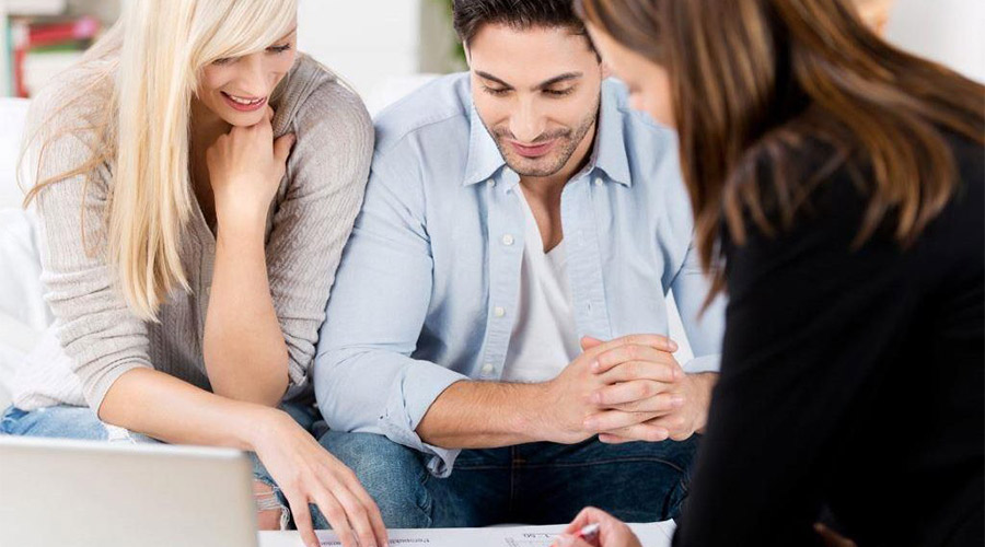wedding planner talking to couple about choices for the wedding day and wedding venue