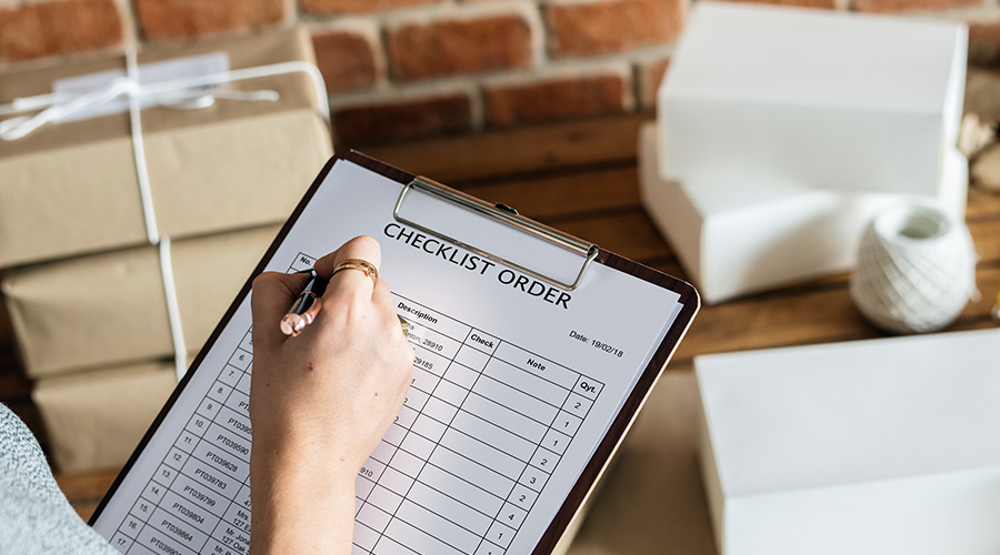 wedding supplier with clipboard and checklist