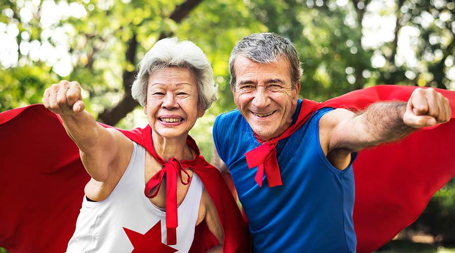 seniors wearing superhero costumes