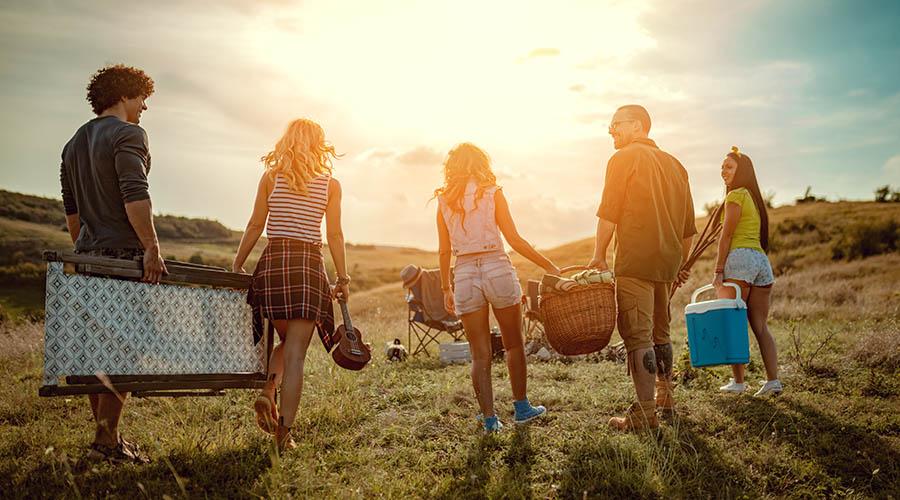 friends holding picnic bundle