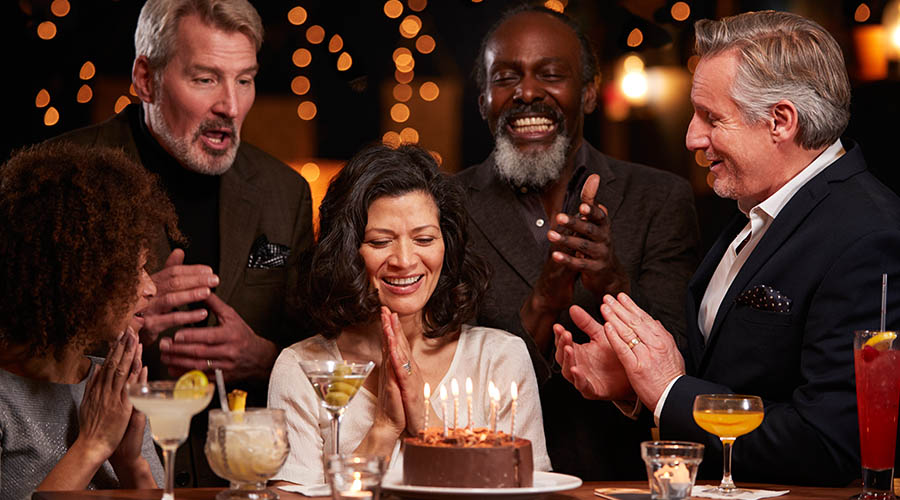 middle aged friends celebrating birthday