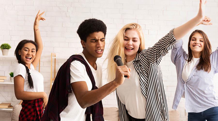 teen friends singing and karaoke