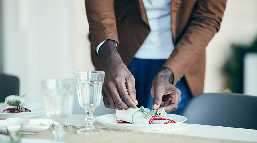 man's hands setting a table