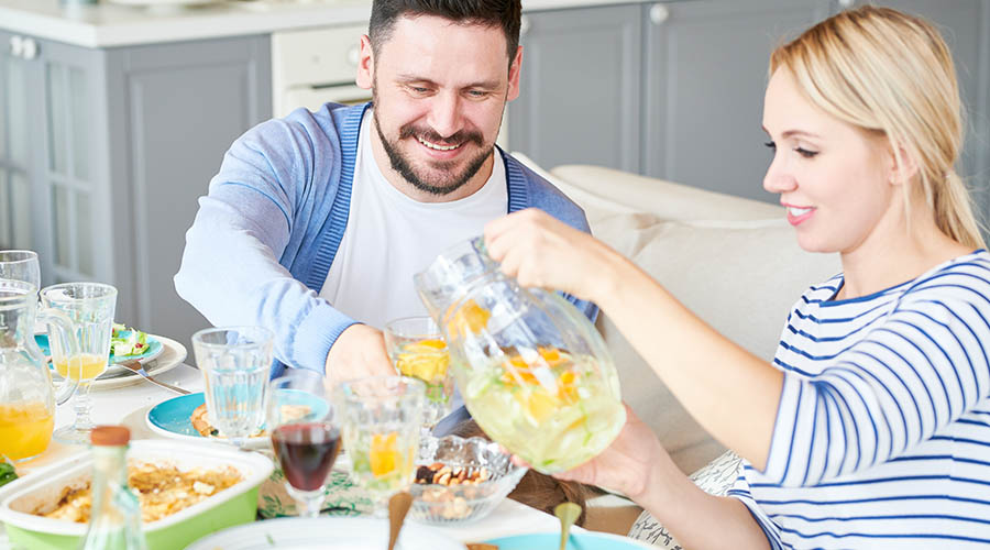 woman pouring drink for man
