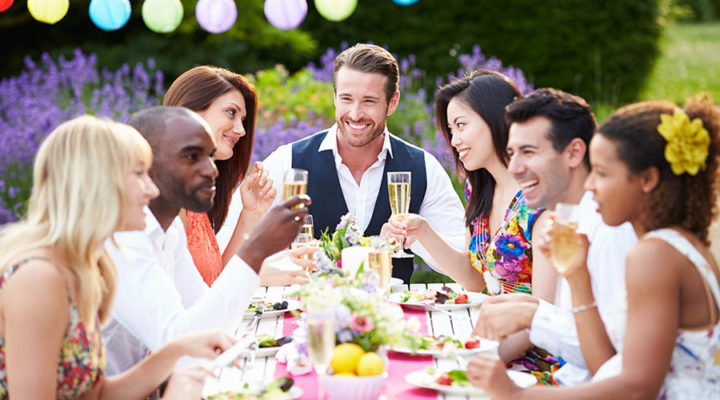 Group of friends enjoying dinner party outside