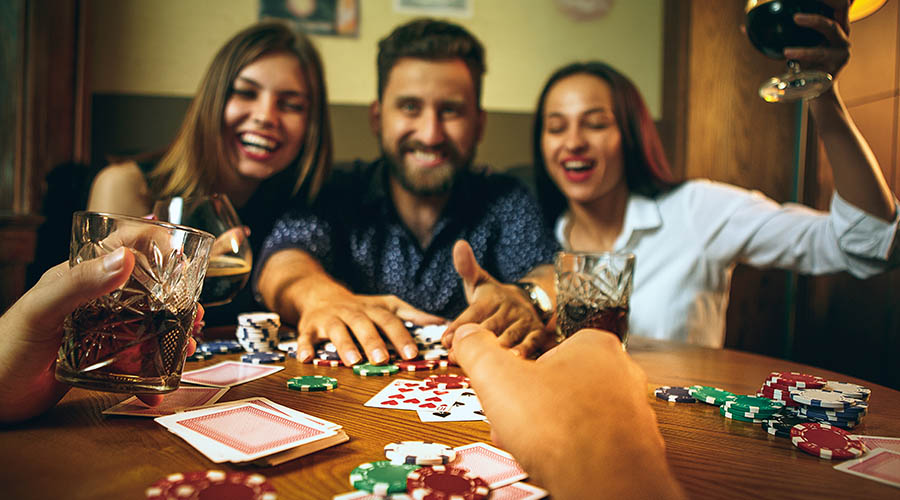 friends laughing and playing poker