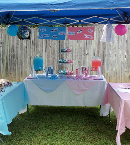gender reveal party with blue gazebo and paper lanterns
