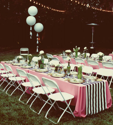 wedding shower seating and table arrangement with white chairs and striped linen